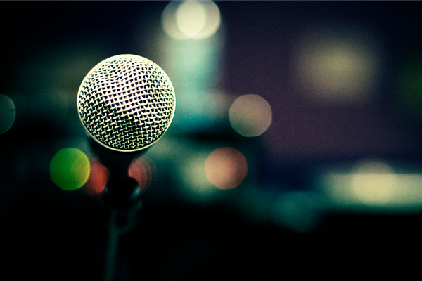 photo of microphone in front of a crowd before keynote
